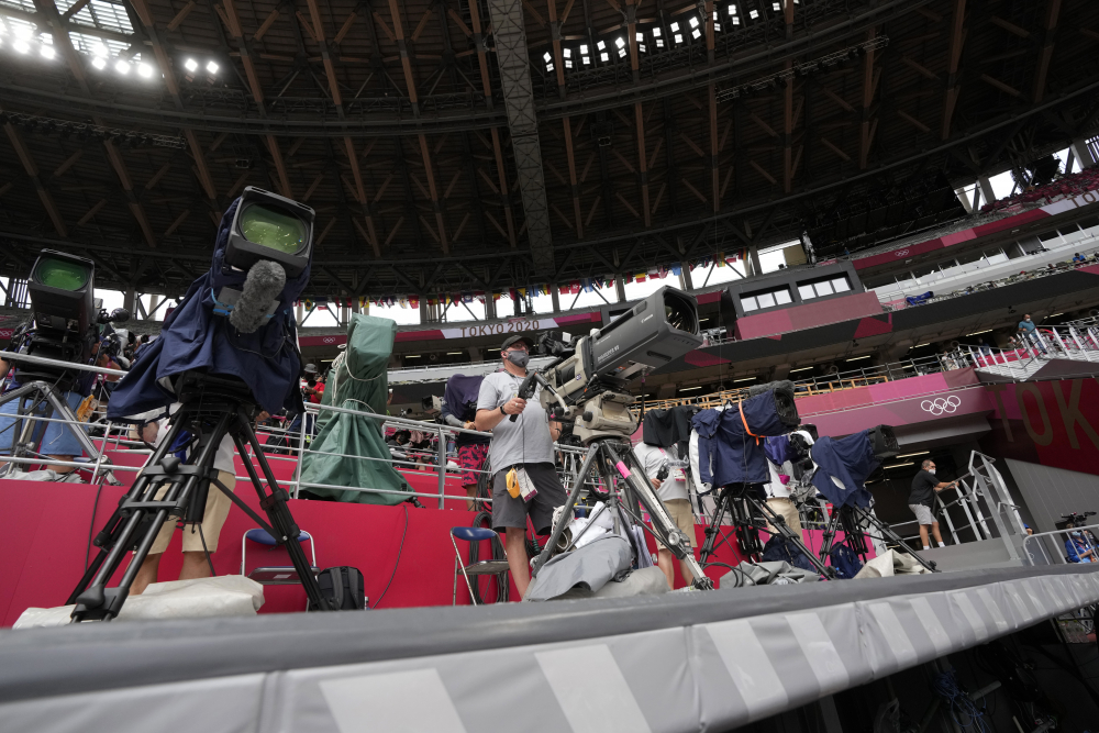 Cameramen work at the Olympics on Saturday in Tokyo.