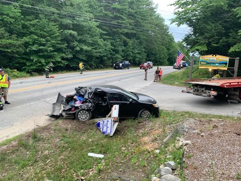 Police say a distracted driver drove into the back of a Toyota Camry in Standish Wednesday, sending a woman and three children to the hospital.