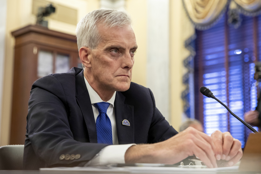 """Denis McDonough, secretary of Veterans Affairs, shown July 14, said Monday, """"Whenever a veteran or VA employee sets foot in a VA facility, they deserve to know that we have done everything in our power to protect them from COVID-19."""""""