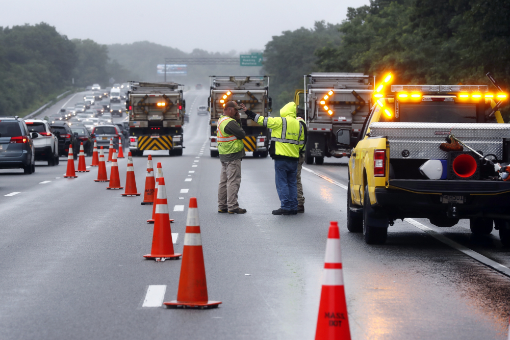 Traffic on Interstate 95 is diverted in the area of an hours long standoff with a group of armed men that partially shut down the highway, Saturday in Wakefield, Mass.