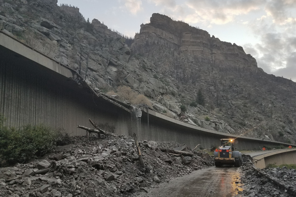 Equipment works to clear mud and debris from a mudslide on Interstate 70 through Glenwood Canyon, Colo., on Friday, July 30, 2021.