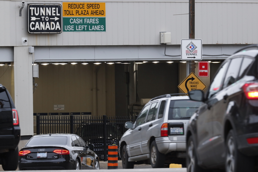 Vehicles enter the Detroit-Windsor Tunnel in Detroit to travel to Canada in March 2020.