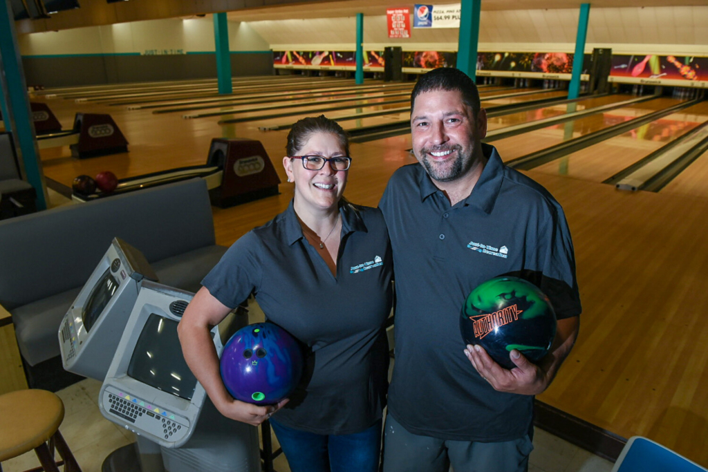 New owners Samantha and Justin Juray stand Tuesday in the former Sparetime Recreation bowling center in Lewiston. The bowling alley is reopening Wednesday as Just-In-Time Recreation.