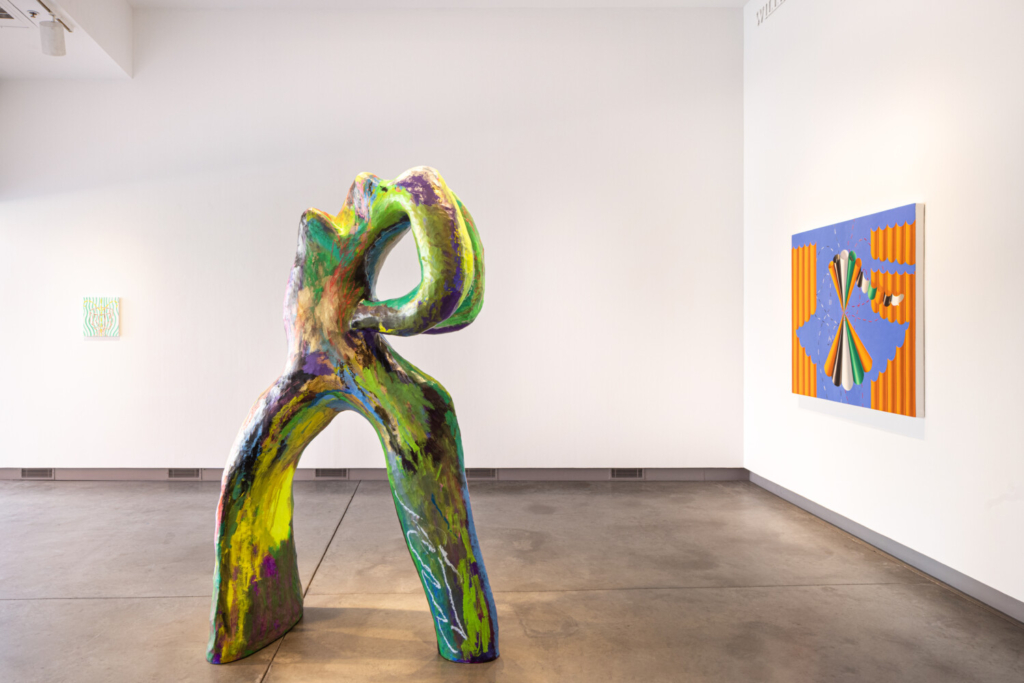 """Installation of """"Double Trouble,"""" with Bianca Beck's """"Untitled"""" at center."""