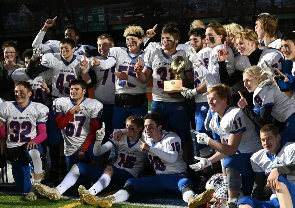 PORTLAND, ME - NOVEMBER 16: Mt. Ararat celebrates with the trophy after winning the 8-man football state championship Saturday Nov. 16, 2019. (Staff Photo by Shawn Patrick Ouellette/Staff Photographer)