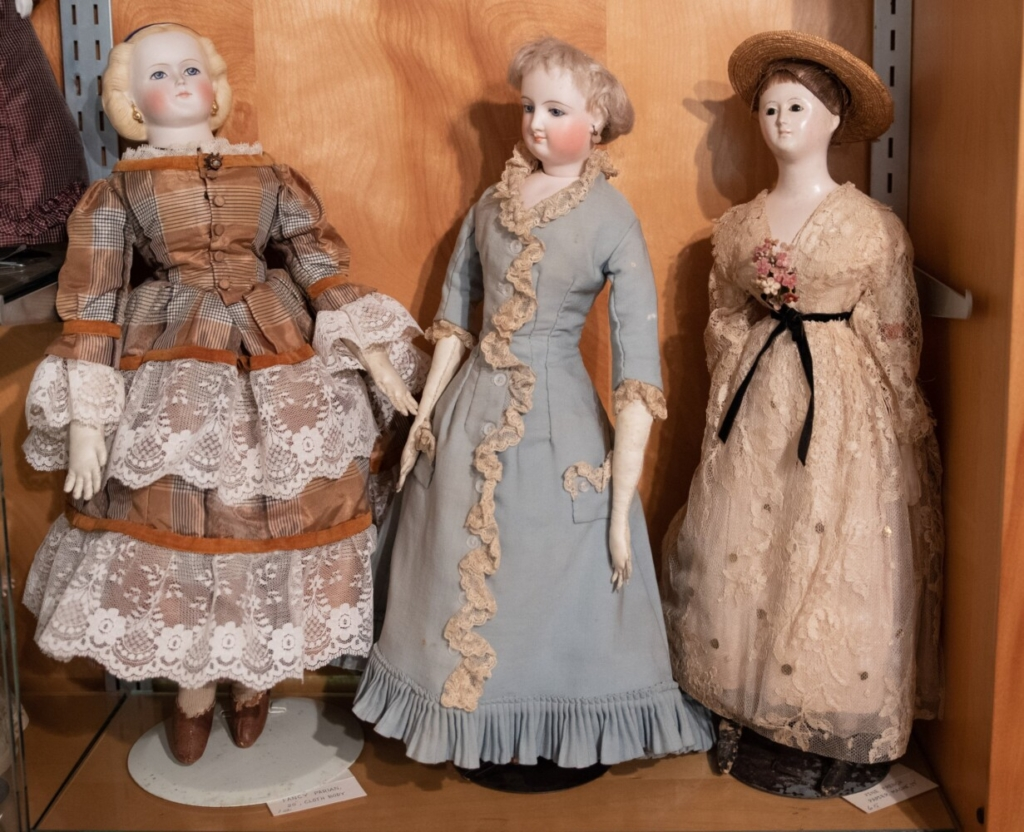 These three dolls are apart of a larger collection on display at the Titcomb House in Farmington.