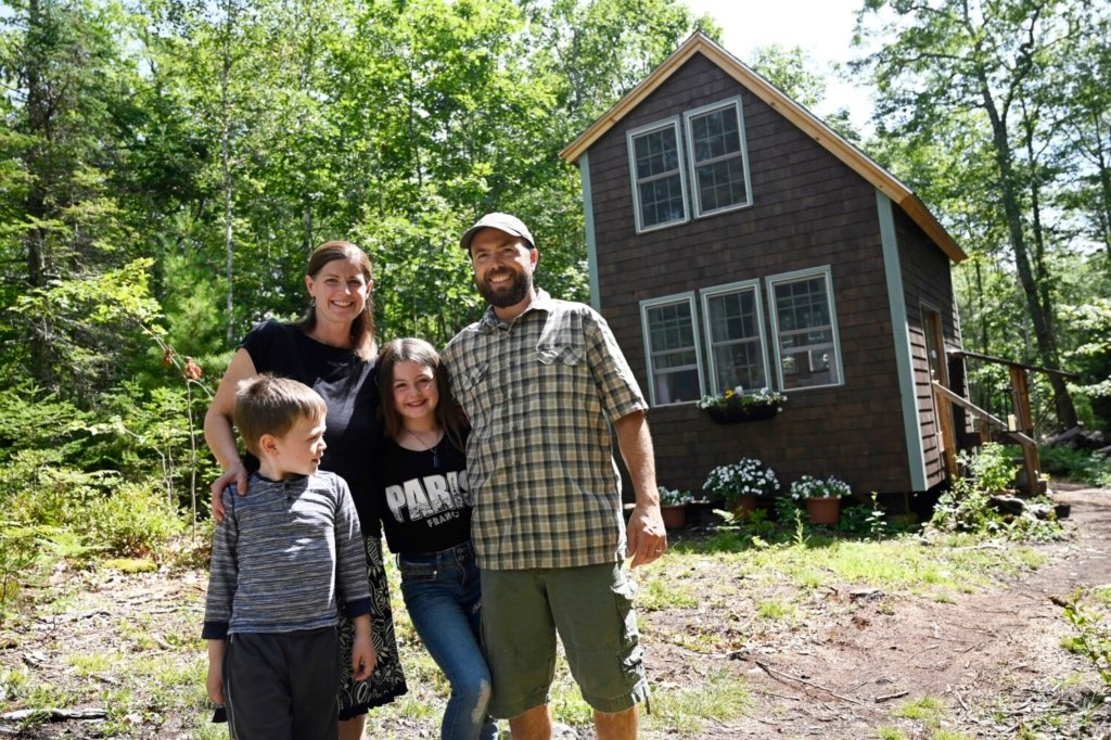 BRISTOL, ME - AUGUST 20: The Herrick Family outside their hipcamp cabin in Bristol Friday, August 20, 2021. L to R are Oliver, 6, Cacy, Emma 10, and Dana. (Staff Photo by Shawn Patrick Ouellette/Staff Photographer)
