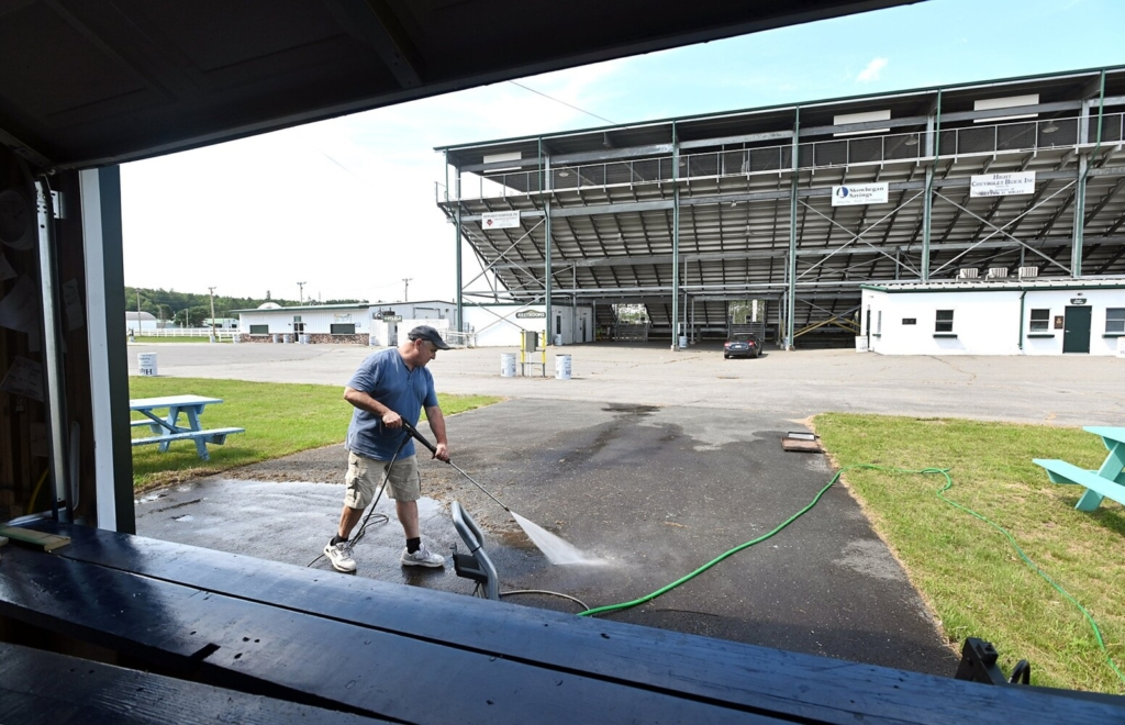 Mike Pelletier of M & M Ice Cream power-washes the driveway in front of his ice cream stand near the grandstands Tuesday, August 3, at the Skowhegan State Fairgrounds. Pelletier, who has served ice cream at the fair since 2012, said he was also power-washing and painting his building before the fair opens. The fair runs from Aug. 12-21.