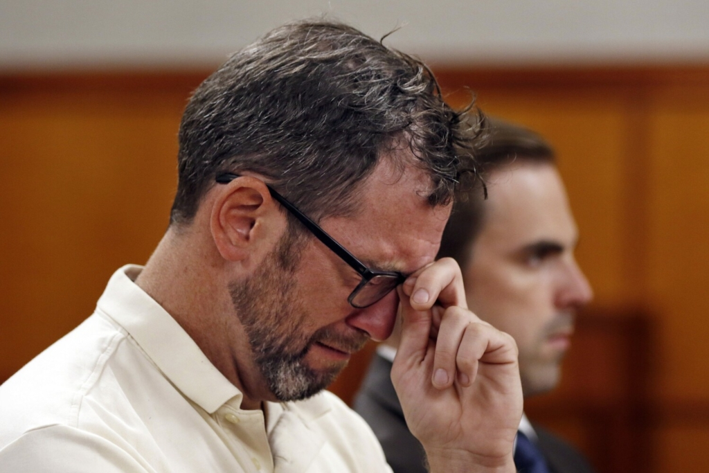 Robert Clarke of Braintree, Massachusetts, who pleaded guilty to aggravated assault during a hearing Tuesday in Cumberland County Superior Court, cries during statements by the victim's family.