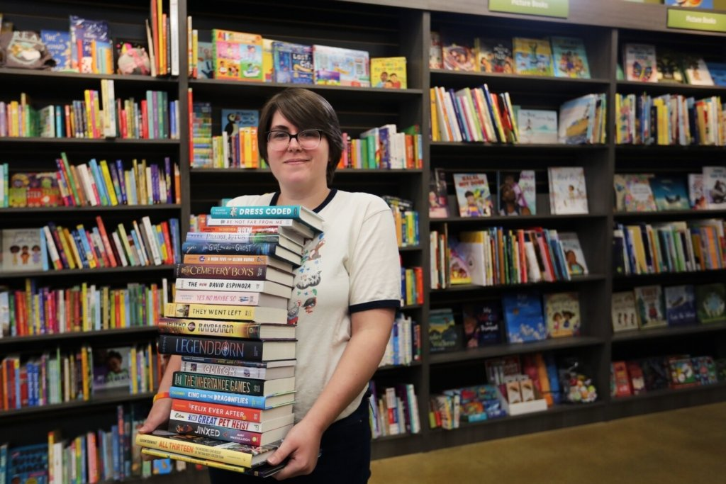 Stephanie Heinz, children's book manager and community coordinator at Print: A Bookstore, holds books that have been donated to replace those that were lost in the fire last week at the Dr. Levesque Elementary School in Frenchville. Heinz said the store started a drive to help replace approximately 9,500 books lost in the fire. So far, about 100 books and $200 in cash have been collected.