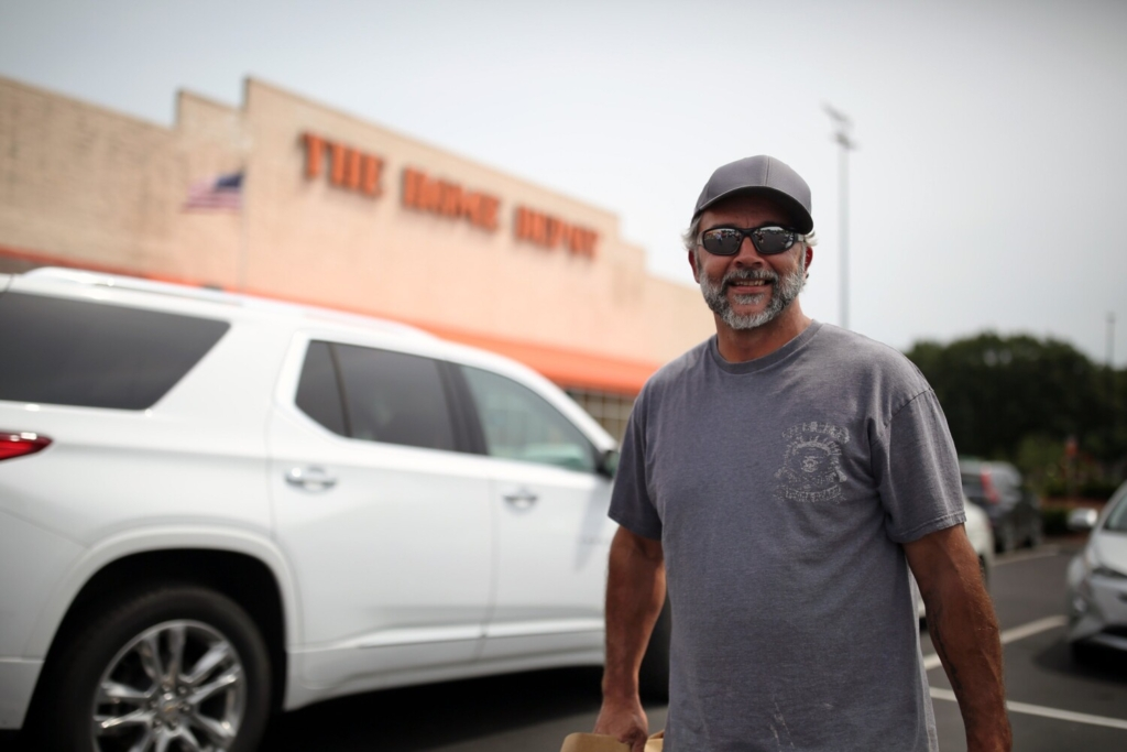 South Portland resident Tom Andrews stands in the Home Depot parking lot in South Portland on Wednesday. Andrews said he recently built a loft and was surprised by the high cost of materials.