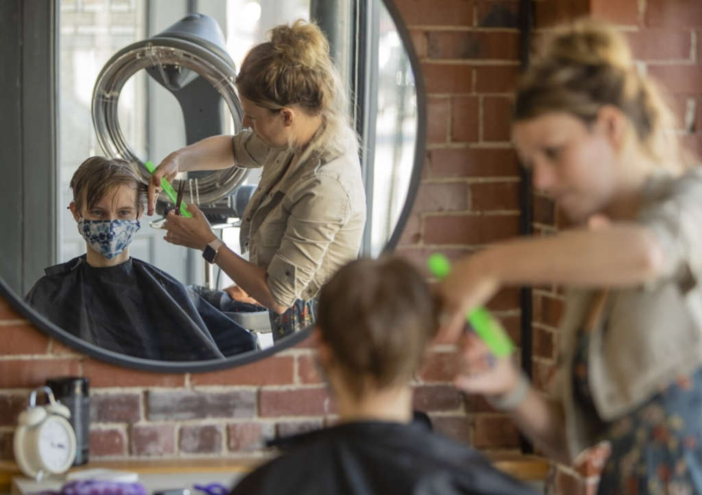 GORHAM, ME: AUGUST 06: Megan Wentworth, 17, wears a mask while having her hair styled by Gorham's Neu Du Salon owner Catherine Chase on Friday, August 6, 2021, 2021. Megan said she was wearing it because she was expected to wear one. Catherine said she leaves it up to the client. (Photo by Carl D. Walsh/Staff Photographer)