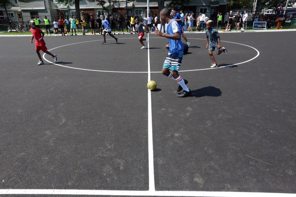 PORTLAND, ME - AUGUST 6:  Futsal players run down court during a demonstration game at an opening ceremony for the newly constructed Futsal Court at Fox Field on Friday morning. Futsal is a soccer-style game on a small scale. Each team has five players, including a goalkeeper, that play on a hard, outdoor surface using a smaller, heavier ball. Each game lasts for one goal or ten minuets, whichever comes first, then new teams or players rotate in. (Staff photo by Ben McCanna/Staff Photographer)