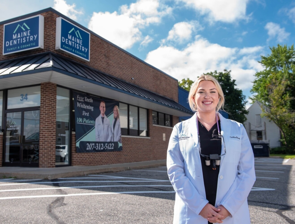 Dr. Katie Clark stands in front of the new Maine Dentistry location in Auburn on Tuesday. The practice opened its third Maine location last week on Center Street with six staff and two dentists.