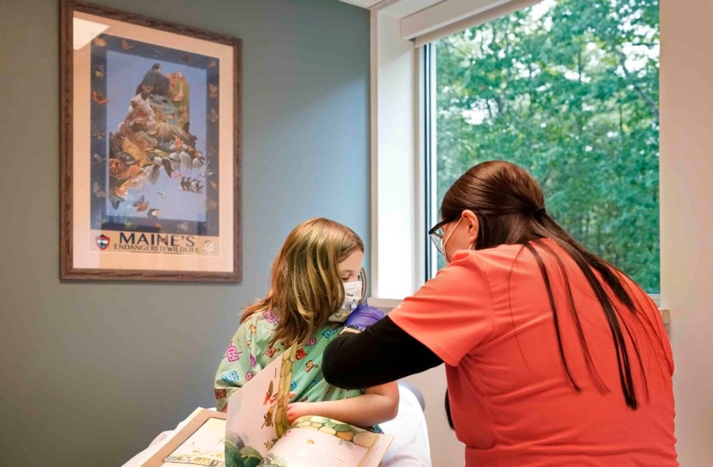 BRUNSWICK, ME - AUGUST 20: Monroe-Claire Forgues, 5, receives the MMR and DTAP vaccines from Tarra Hunt at Mid Coast Medical Group Pediatrics in Brunswick on Friday, August 20, 2021. (Staff photo by Gregory Rec/Staff Photographer)