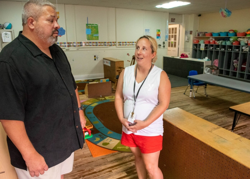 Steve Wallace, CEO of the YMCA of Auburn-Lewiston in Auburn, talks to Susan Remalia, the assistant director of childhood education, on Thursday in one of the classrooms at the Y.