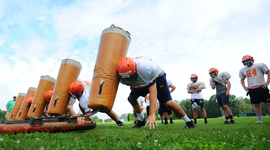 Winslow High linebackers work through a blocking drill during a practice on Wednesday. By Thursday night, the team learned that it would need to shut down practices because of COVID-related issues.