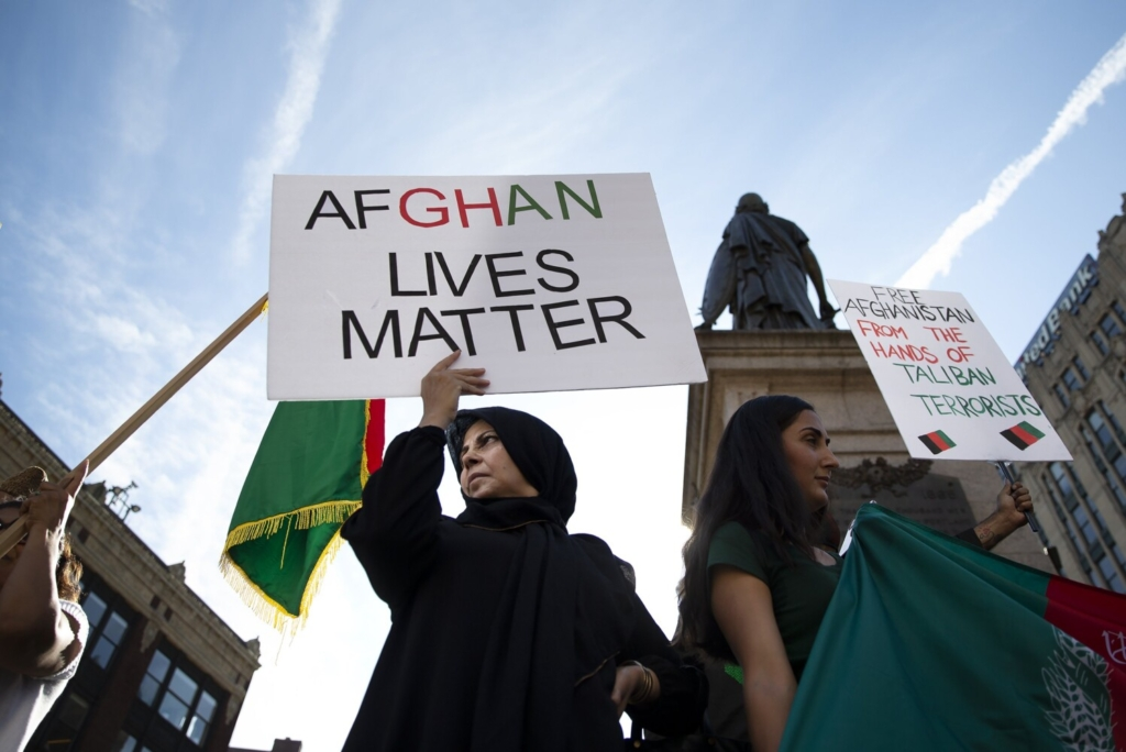 PORTLAND, ME - AUGUST 20: Zezenab Hedayat of Portland holds a sign while demonstrating with fellow members of Maine's Afghan-American community in Monument Square on Friday to call attention to the plight of loved ones in Afghanistan. (Davis/Staff Photographer)