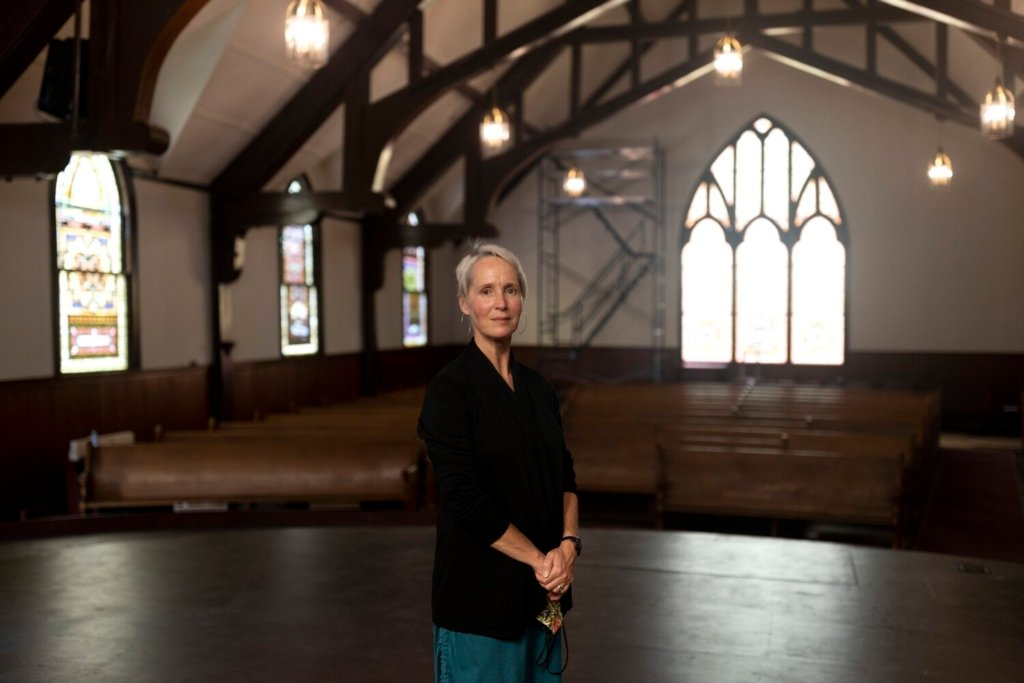 Dana Wieluns Legawiec, the executive director of the Arts & Cultural Alliance of Freeport, at Meeting House Arts in the existing First Parish Church Congregational on Main Street. Meeting House Arts and the church will share the worship space, which will continued to be used by the church on Sundays and holidays.