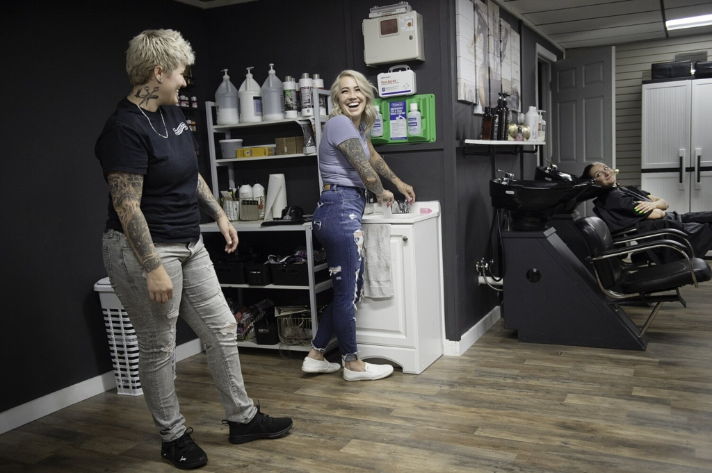 Christina Tucci, left, and her wife, Breeanna, center, own Tucci & Co. Salon together. Reagan Nadeau, right, is a regular client of the Lewiston salon.