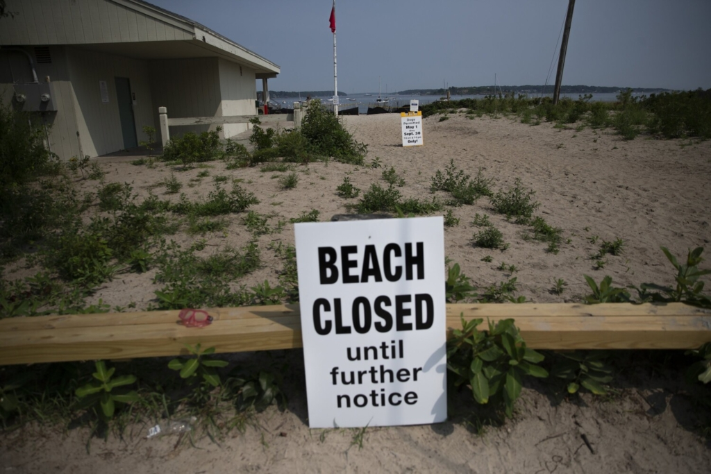 SOUTH PORTLAND, ME - AUGUST 25: Willard Beach in South Portland was closed on Wednesday after oil spilled into a stormage drain nearby. (Davis/Staff Photographer)