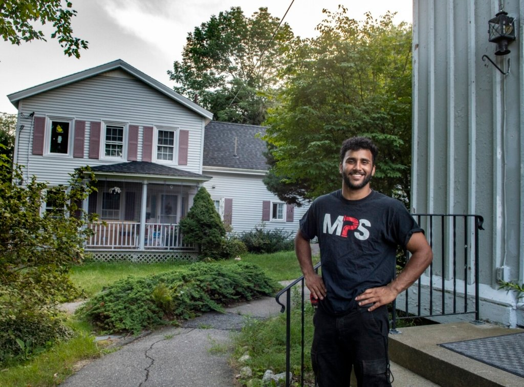 Hussein Albraihi stands in the Capital Area New Mainers Project's small complex Thursday in Hallowell.