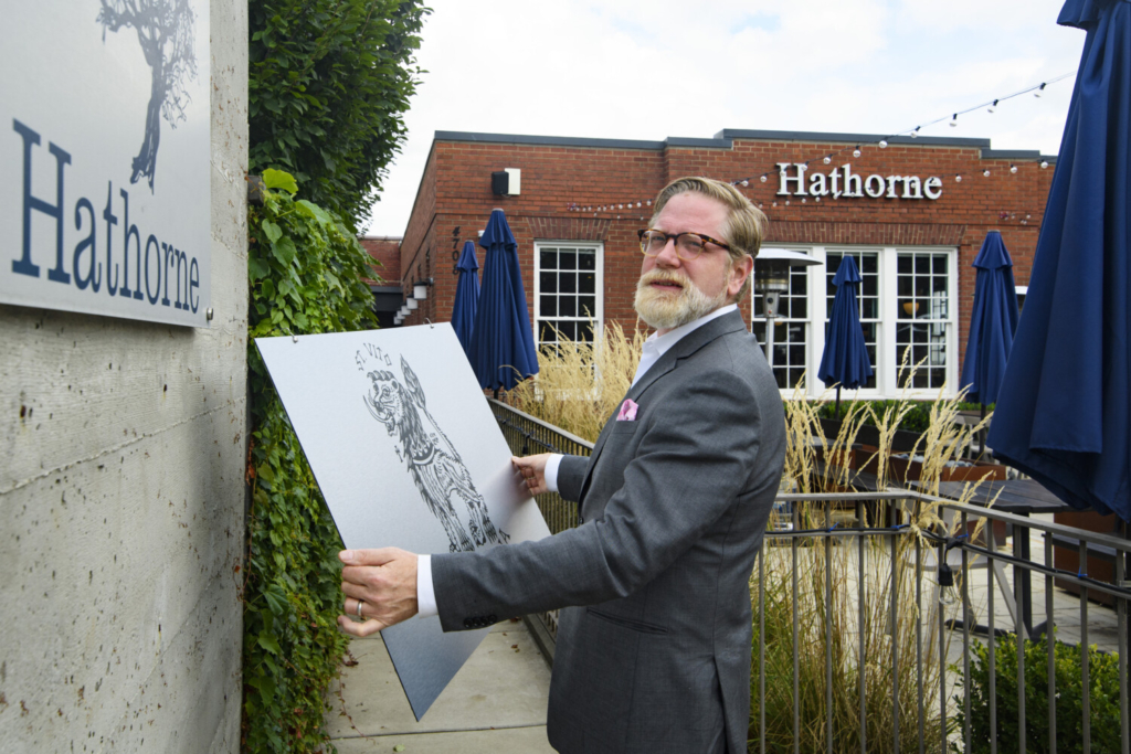 Hathorne restaurant owner John Stephenson holds a sign for a pop-up on Wednesday in Nashville, Tenn. Hathorne has hosted about 10 pop-ups featuring local area chefs since the pandemic began.