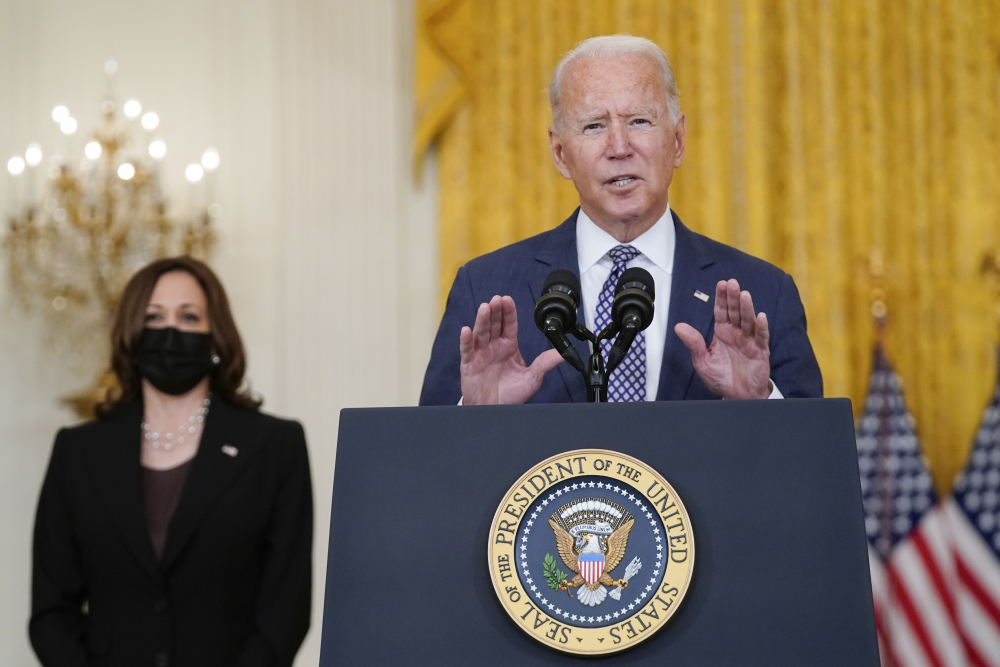 President Biden speaks about the evacuation of American citizens, their families, special visa applicants and vulnerable Afghans in the East Room of the White House on Friday. Vice President Kamala Harris listens at left.
