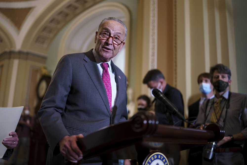 Senate Majority Leader Chuck Schumer, D-N.Y., speaks to reporters at the Capitol in Washington on Tuesday.