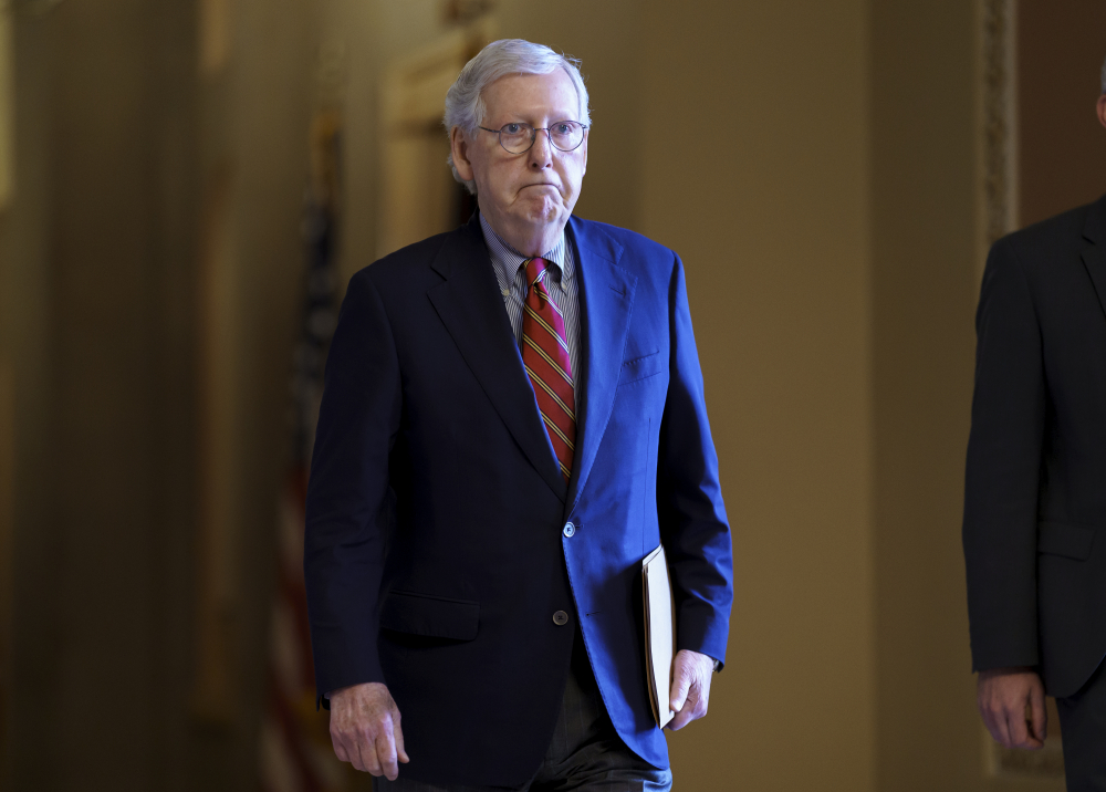 Senate Minority Leader Mitch McConnell, R-Ky., walks to the chamber as the Senate works to advance the $1 trillion bipartisan infrastructure bill, at the Capitol in Washington on Monday.