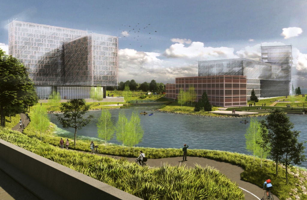 This conceptual rendering of the planned Roux Institute campus on the B&M Beans site in Portland shows the B&M building in foreground with the Roux Institute facility behind it, housing with underground parking to the left, along with a restored coastline, public spaces and a new bike trail.