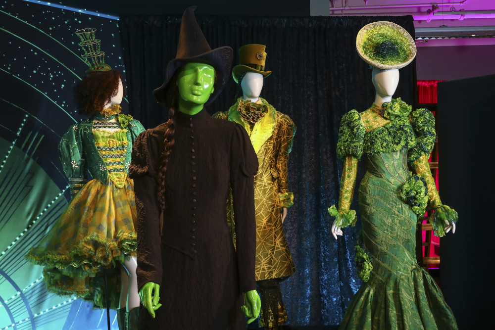"""Costumes from the Broadway musical """"Wicked"""" are displayed at the """"Showstoppers! Spectacular Costumes from Stage & Screen"""" exhibit, benefiting the Costume Industry Coalition Recovery Fund, in Times Square on Monday in New York."""
