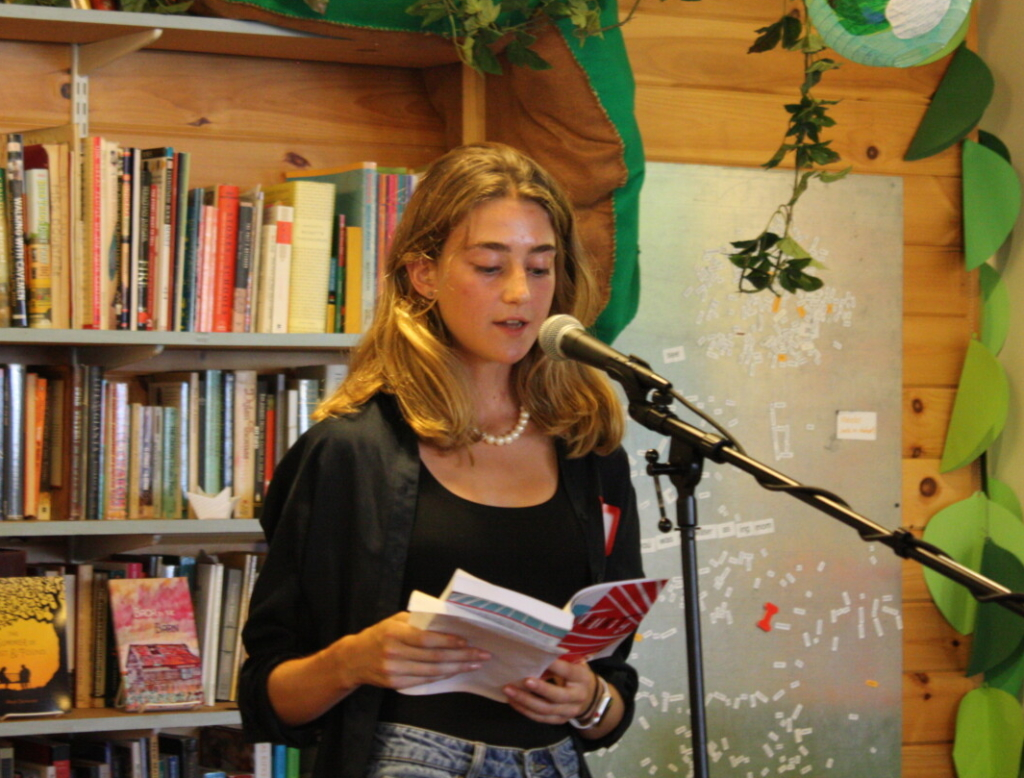 """Recent Falmouth High grad Sofie Matson reads an excerpt from her novel, """"Amateurity,"""" at The Telling Room on Thursday."""