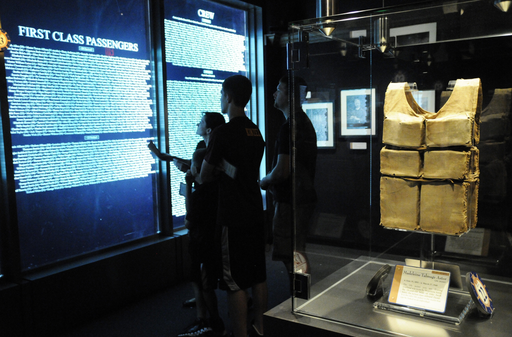 Visitors check the passenger list against their boarding pass to see if they were a survivor or casualty of the sinking of the ship at the Titanic Museum in Pigeon Forge, Tenn.(Curt Habraken/The Mountain Press via AP, File)