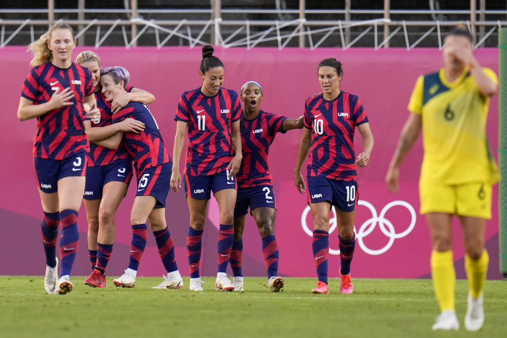 United States' Megan Rapinoe celebrates with teammates scoring her side's 2nd goal against Australia in the women's bronze medal soccer match.