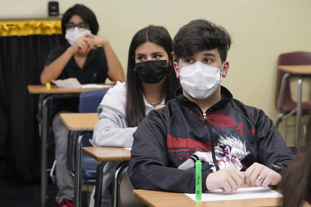 Students sit in an algebra class at Barbara Coleman Senior High School on the first day of school, Monday, Aug. 23, in Miami Lakes, Fla. Miami-Dade County public schools require students to wear a mask to prevent the spread of COVID-19.