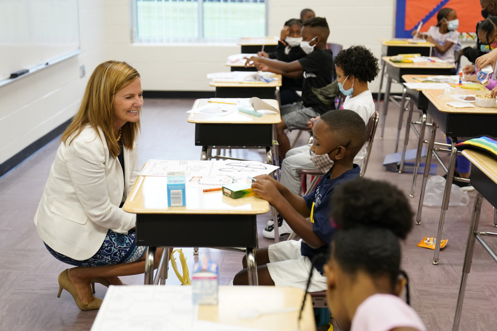 Henry County Board of Education Chair Holly Cobb, left, talks to students at Tussahaw Elementary school on Wednesday, Aug. 4, 2021, in McDonough, Ga.