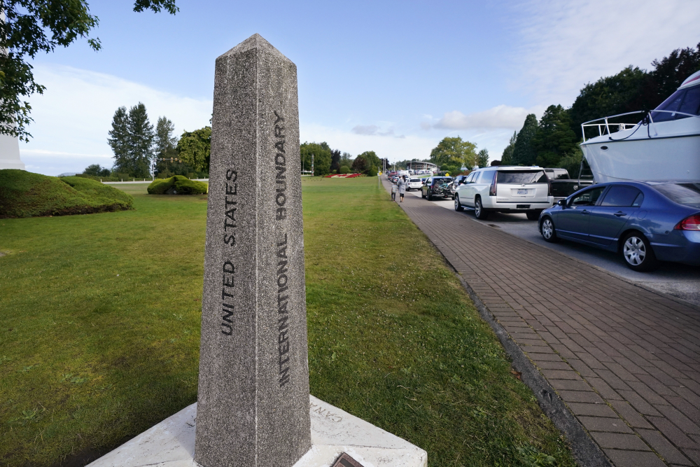 Vehicles wait to enter Canada at the Peace Arch border crossing Monday in Blaine, Wash.