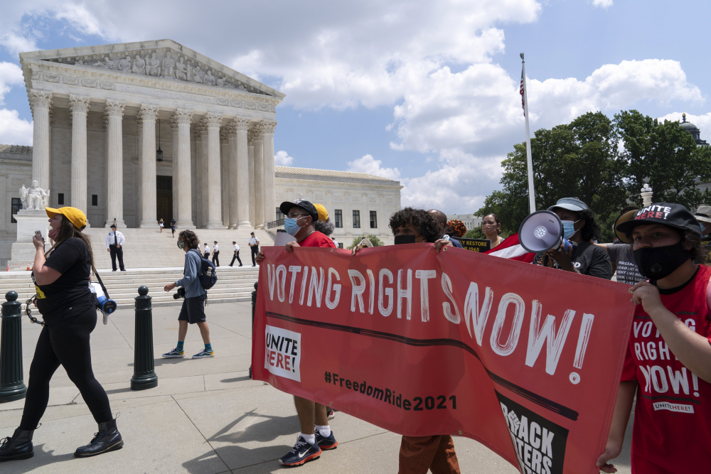 Voting rights activists march outside the U.S. Supreme Court, during a rally Aug. 2 on Capitol Hill in Washington. In the nation's capital on Saturday,  multiracial coalitions of civil, human and labor rights leaders are convening rallies and marches to urge passage of federal voter protections that have been eroded since the Voting Rights Act of 1965.