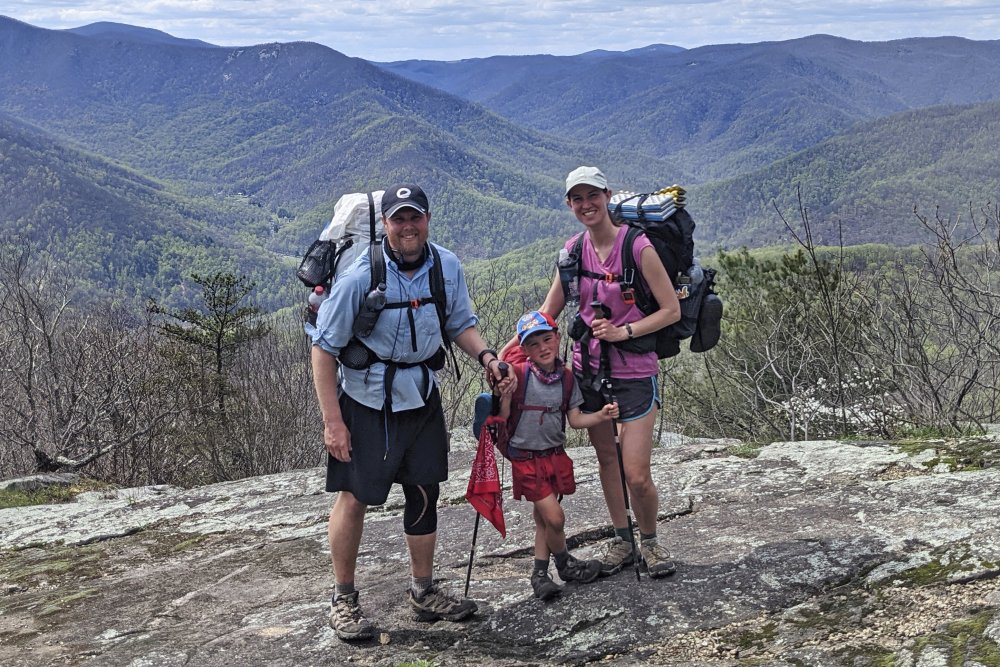 Five-year-old Harvey Sutton poses with his mom, Cassie, and dad, Joshua, at a mountain top in Three Ridges, Virginia, while hiking the Appalachian Trail on April 11.