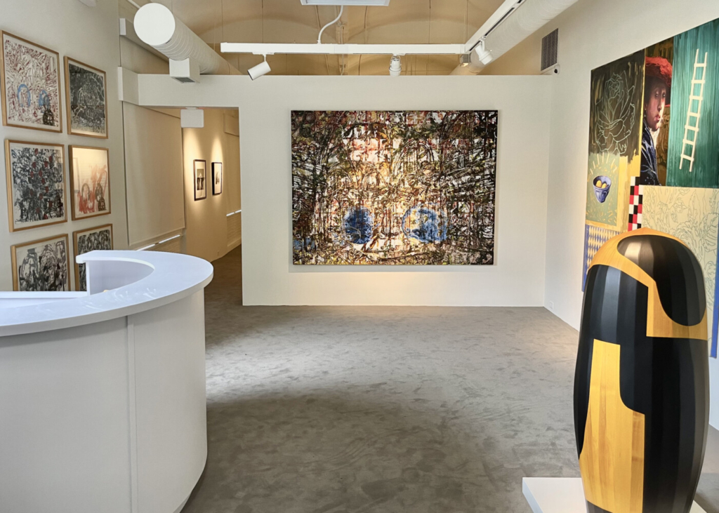 """The Friends Gallery at the expanded Zillman Museum of Art, with paintings by French-American artist John Bailly (far wall), a painting titled """"Harlequin's Romance"""" by James Linehan and, in the foreground, the sculpture """"Parkway"""" by Steve Bartlett."""