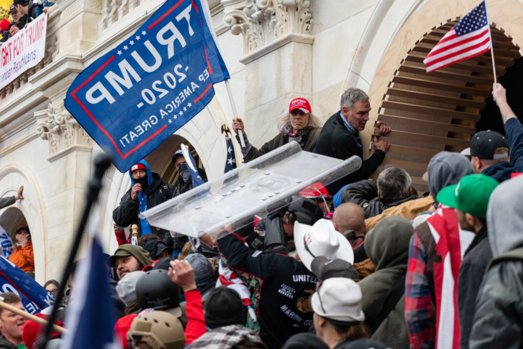 Demonstrators steal a Metropolitan Police riot shield while attempting to enter the U.S. Capitol building in Washington, D.C., on Jan. 6, 2021. MUST CREDIT: Bloomberg photo by Eric Lee.