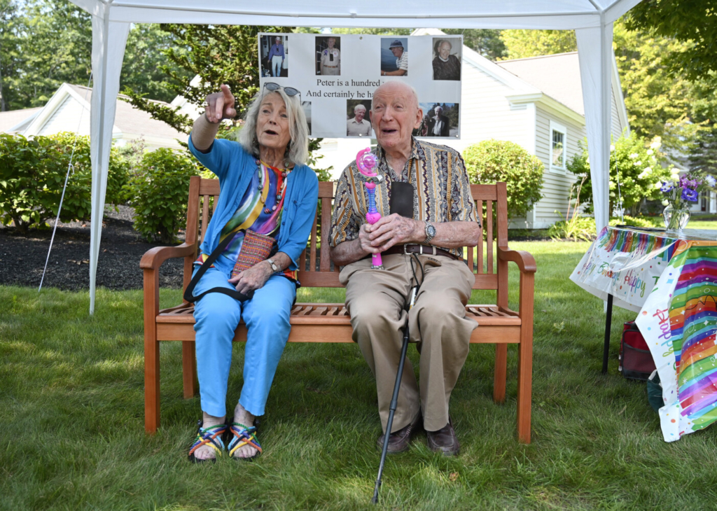 TOPSHAM, ME - AUGUST 12: Nancy and Peter Kaye sit on the bench that Nancy had installed along Peter's daily walking route at the Highlands, a retirement community where they live in Topsham Thursday, August 12, 2021. (Staff Photo by Shawn Patrick Ouellette/Staff Photographer)