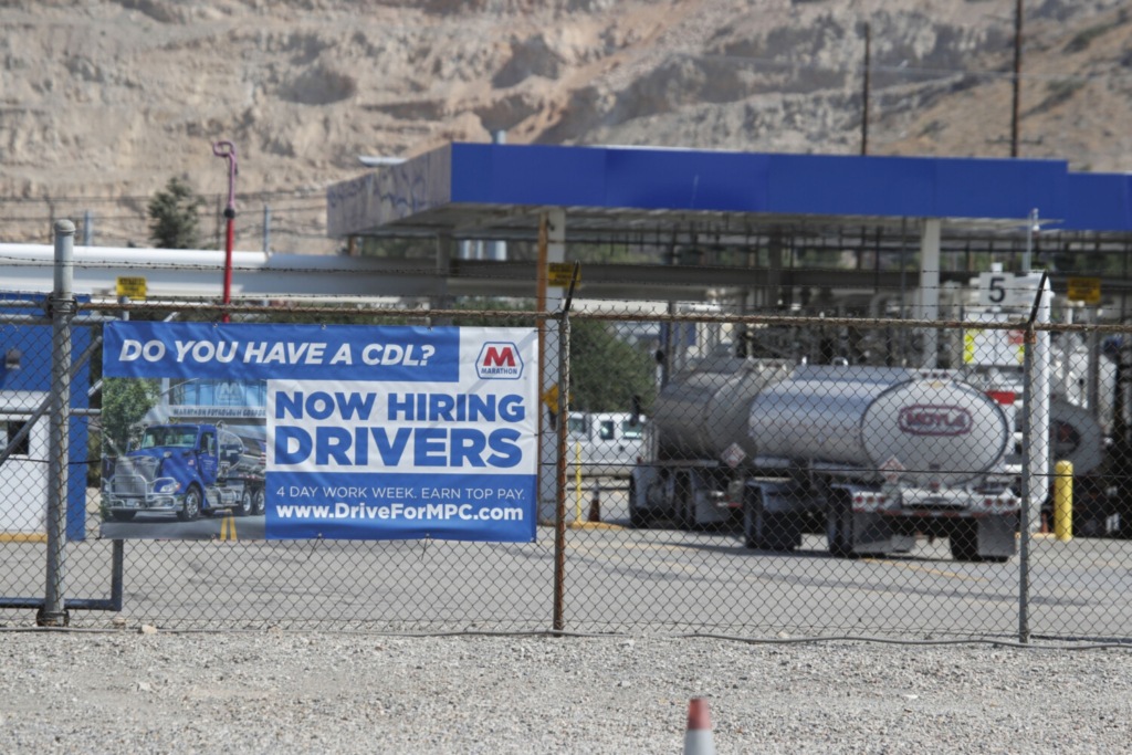 A Marathon Petroleum oil refinery in Salt Lake City posts a hiring sign for drivers. In 2019, the U.S. was already short 60,000 drivers, according to the American Trucking Associations. That number is anticipated to swell to 100,000 by 2023, according to Bob Costello, the group's chief economist.