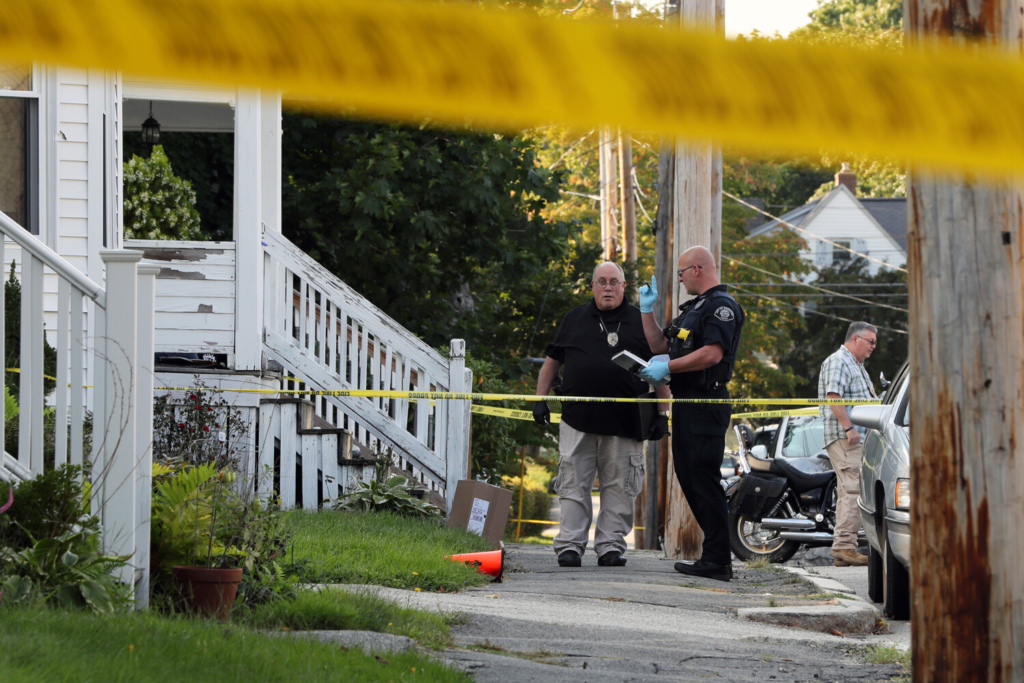 Police investigate the fatal shooting Tuesday on Union Street in Biiddeford.