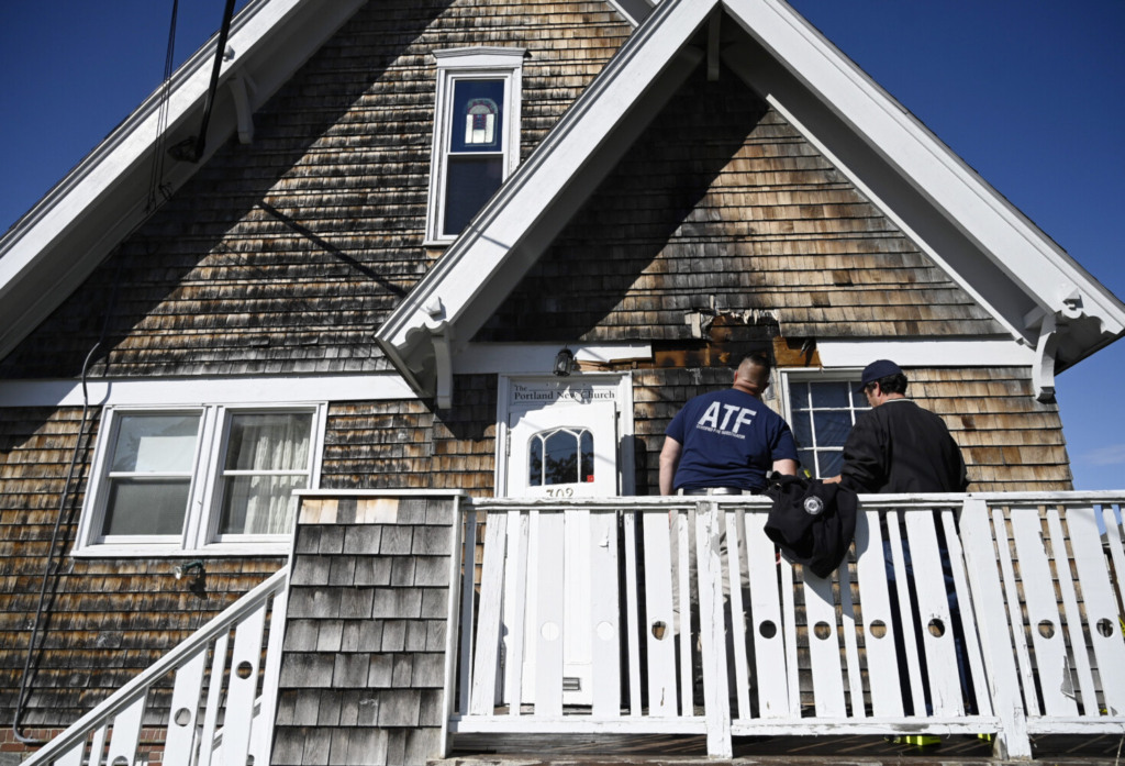 PORTLAND, ME - SEPTEMBER 27: Investigators look over the damage done by suspected arson at Portland New Church Monday, September 27, 2021. (Staff photo by Shawn Patrick Ouellette/Staff Photographer)