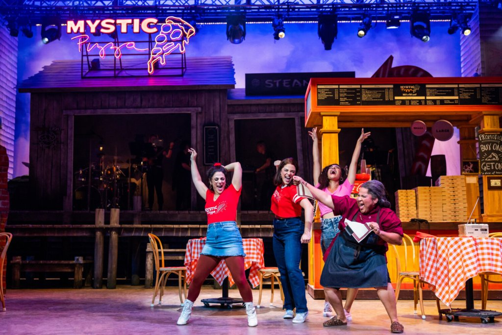 """Gianna Yanelli as Jojo, Kyra Kennedy as Kat, Krystina Alabado as Daisy and Rayanne Gonzales as Leona in the world premiere of the musical """"Mystic Pizza"""" at Ogunquit Playhouse."""