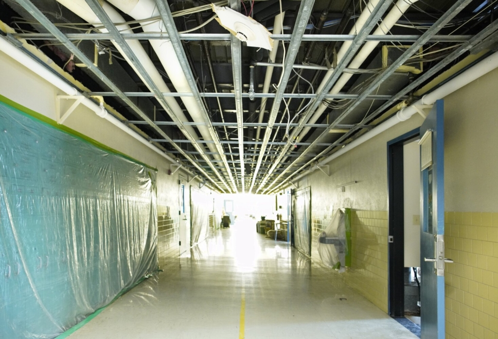Ceiling tiles were removed from a hallway at Westbrook High School because of a fire and subsequent water damage that has closed the school and forced students back to remote learning.