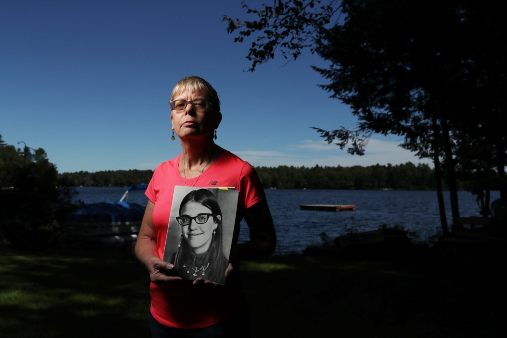 WINDHAM, ME - SEPTEMBER 16: Kim Higgins, holds a photo of her older sister, Cathy Moulton, who went missing from Forest Avenue in Portland on Sept. 24, 1971. Police believe she left Portland with her boyfriend, was held against her will and ultimately died on a reservation in New Brunswick. Her body has never been found and no one has been charged in her disappearance. (Staff photo by Ben McCanna/Staff Photographer)