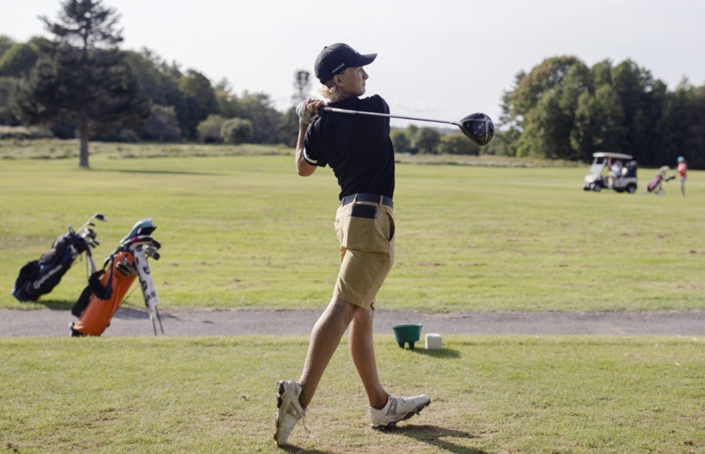 Freeport High sophomore Eli Spaulding tees off at the third hole during a match Tuesday at Freeport Country Club.